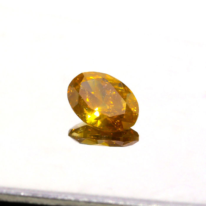 0.77 ct. Natural Fancy Deep Brownish Orangy Yellow Oval Brilliant Cut Diamond, GIA Certified