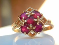 Numbered ring with 5 lovely natural rubies in 18 kt gold