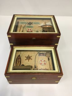 2 nautical nestable chests with nautical interior