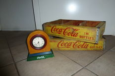2 old yellow wooden crates for bottles of Coca-Cola and a clock of Coca-Cola - 1966 - America