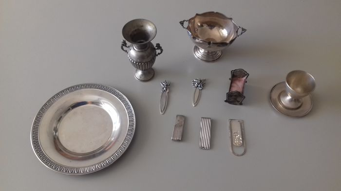 Lot of silver items. Italy, 20th century
