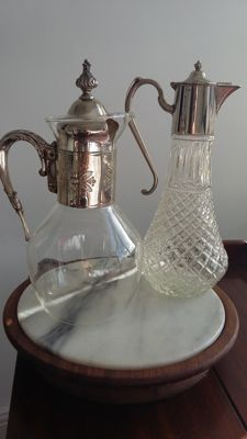 two decanters water jug silver plated 1crystal 1 glass made in england.