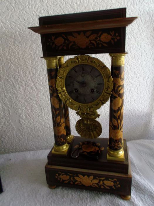 French rosewood column mantel clock inlaid with lemon tree wood.