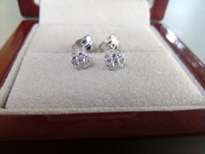 Pair of 18 kt white gold stud earrings with diamonds weighing 0.23 ct