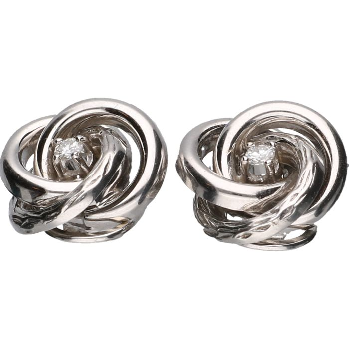 14 kt White gold clip-on earrings each set with a brilliant cut diamond of approx. 0.14 ct in total - length x width: 1.7 x 1.7 cm
