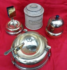 Decorative set of smoking accessories, copper ashtray with cigar cutter, cigar jar, ashtray with match box and tobacco jar, decorated with cork and leather.