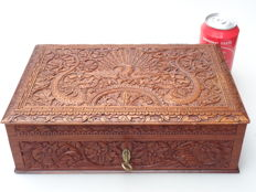 Mahogany oriental box with carving of a peacock, 2 snakes and floral depictions - first half 20th century