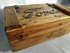 Vintage wooden crate, garage style with a metal Ford logo on the lid