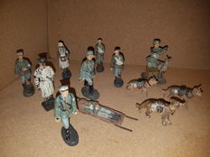 Lineol, Elastolin, etc. 12 composite Wehrmacht figures. Includes soldier with dove cage and german sheppards.