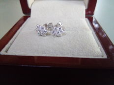 Pair of 18 kt white gold stud earrings with diamonds weighing 0.46 ct