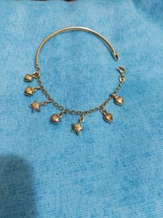 Bracelet in 18 kt gold with charms 20 cm
