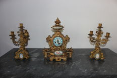 Clock with 2 candelabras in antimony and Sevres, Napoleon III, France, 19th century.