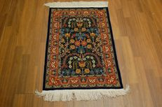 Valuable handwoven silk carpet I Hereke silk on silk SIGNED Hereke fine 1.000.000 knots per square metre 85 x 65 cm
