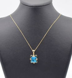 14 K yellow gold necklace  with blue topaz stone  45 cm   approx