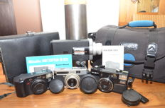 Lot especially for the Minolta collector with 3 photo and 1 film camera along with Minolta camera bag and ever-ready bags