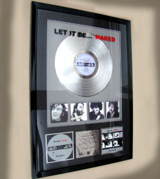 """The Beatles Presented to Paul McCartney """"Let it Be Naked"""" 1 million sales"""