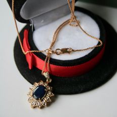 About 60x Germany Gold entourage Pendant with Chain set with natural Sapphire ca. 1.50Ct. and small old cut diamonds.
