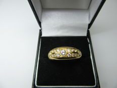 Gold ring set with brilliant cut diamonds.