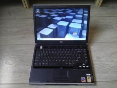 HP dv1000 vintage notebook - Intel Pentium M 1.4Ghz, 2GB RAM, 30GB HDD, Nvidia Geforce GO FX5700, Windows 7 - with charger