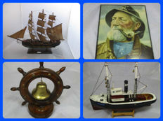 A Maritime collection with 4 Pieces: A model of the Fragata Siglo XVIII, A model of a fishing boat, A shrimp fisherman in a frame, and a ship's wheel with a bell
