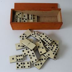 Domino game of bone with ebony in ash wood box, Netherlands, ca. 1920