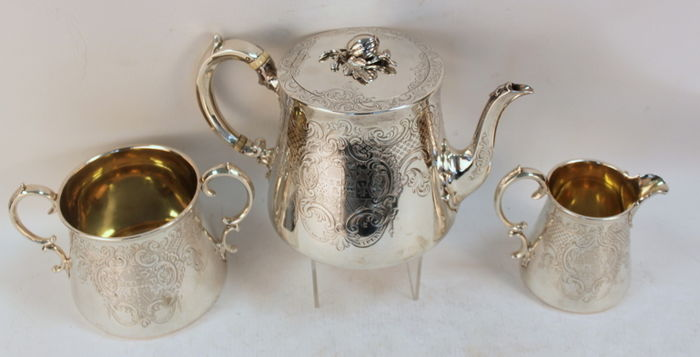 An elaborately engraved Victorian three piece silver tea service - Edward, Edward junior & John & William Barnard - London - 1842/1845