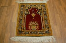 Valuable handwoven silk carpet I Hereke silk on silk SIGNED Hereke fine 1.000.000 knots per square metre 75 x 53 cm