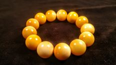 Perfect polished round beads rare modified Egg yolk - Ivory colour Baltic Amber  bracelet, hole diameter ca. 60 mm, 45 grams
