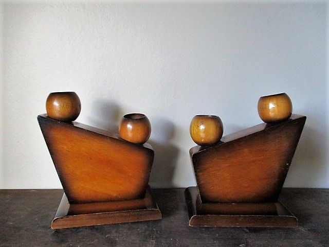A pair of 'Amsterdam School' wooden candle holders, marked C&B