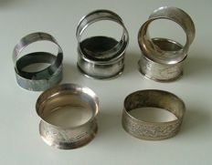 3 pairs and two individual sterling silver napkin rings. ( 8 in total ) Date range 1901 - 1939.