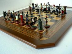 Chess of tin soldiers. Wooden board.
