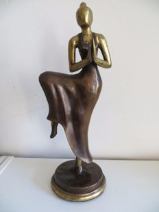 Bronze sculpture of a dancer in a meditative posture