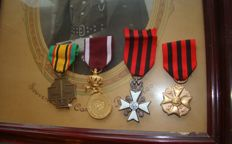 4 orders, decorations and a photo of an officer in a frame from WWII
