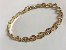 Bracelet with hinged links in three tones of 18 kt gold (white, yellow, rose), total weight 9.20 g, length 193 mm, width 6 mm