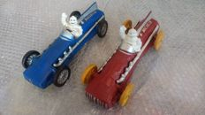 Reproduction: Lot of 2 mascots Bibendum Michelin in cast-iron in their sports car - year of re-edition 1972 - reproduction of the original by Hubley in 1934