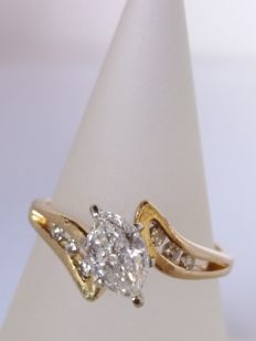 Engagement ring with marquise-cut diamond of 0.82 ct, colour G, clarity P2, and brilliant-cut diamonds of 0.18 ct, colour G, clarity S1