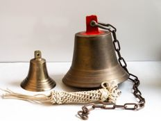A small brass and a large copper ship's bell