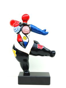 Colourful statue of a dancing woman