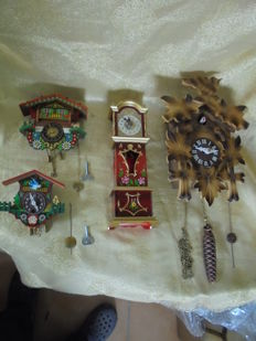 4 Black Forest clocks to hang up - includes a rare winter coat movement - for collectors or lovers. Germany from 1965-1980