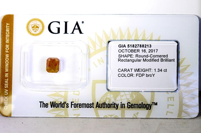 GIA sealed diamond - 1.34 ct - Fancy deep brownish orangey yellow - * NO RESERVE PRICE *