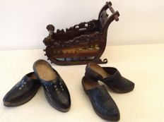 Wooden hand-painted sleigh and 2 pairs of old wooden clogs
