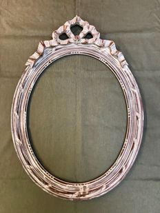 Oval wood-carved frame with bow, France, mid 20th century