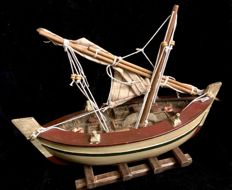 A vintage ,  wood handcrafted  , model of a mediterranean fishermen´s ship  , Circa 1960´s