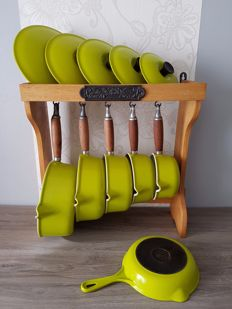 Set of five pans (Le Creuset Made in France) in cast iron enamel with holder