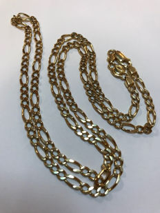 Yellow gold chain (18 kt), with metal purity hallmarks and the maker's mark of the brand (Bruno). Curb link chain. Length 57 cm