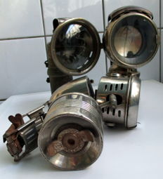 A lot with three old carbide bicycle lamps