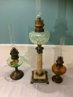 Three oil lamps with a glass oil container and a metal base - circa 1920