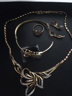 Set with gold necklace, earrings, ring and bracelet