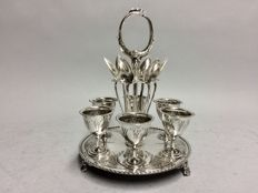 Four silver plated egg cups and spoons in a silver plated mounting, Sheffield, England, ca. 1900