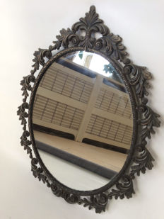 Vanity mirror with nicely decorated brass frame